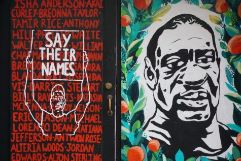 A mural of George Floyds face in downtown Portland, alongside the names of other Black Americans who died at the hands of police.