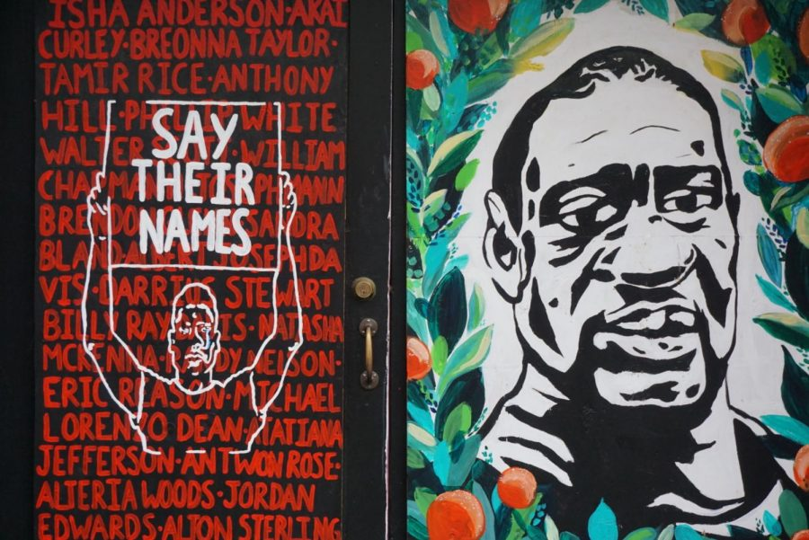 A+mural+of+George+Floyds+face+in+downtown+Portland%2C+alongside+the+names+of+other+Black+Americans+who+died+at+the+hands+of+police.+