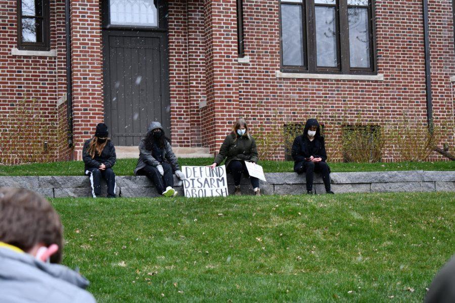 (From left) Senior Evelyn Lillemoe, senior Aman Rahman, junior Ellie Murphy, and senior Gavin Kimmel sit in a minute of silence in honor of police brutality victim Daunte Wright.