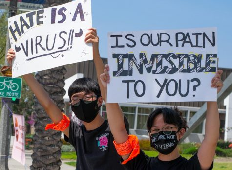 WE ARE NOT A VIRUS: America's youth speaks up during a Stop Asian Hate protest organized by Melanated Youth.