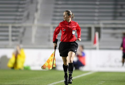 "Running along the sideline, teacher and coach Jennifer Garner watches the match. Garner has been a professional referee since 2013 and received her FIFA badge in 2018. ""I truly love the game of soccer and the reason I started refereeing is because I wanted teams and players to have referees that care and that put in a lot of work and effort to do the best job that they could,"" Garner said. ""As a player, I always noticed when a referee truly was working hard and truly cared as opposed to sometimes having referees that are just there."""