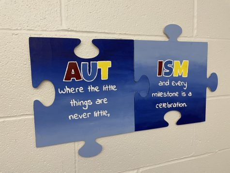 Puzzle pieces hang in the transition room promoting Autism awareness.