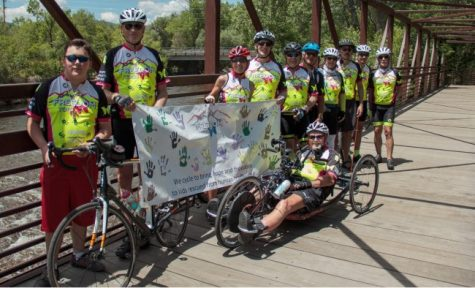 Bikers from the 2020 freedom tour, along with Rich Dixon (front) pose during a break in their ride. This group biked over 200 miles in four days.