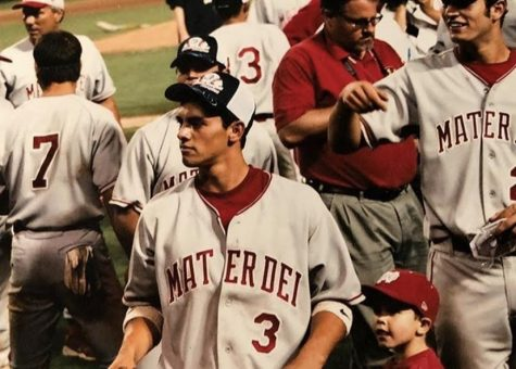 """A FAMILY AFFAIR: 2 year old Cade O'Hara stands next to half-brother, 18 year old Michael Torres after the 2005 Mater Dei baseball team wins the CIF Championship. 16 years on, O'Hara now wears that same uniform, representing Mater Dei. Torres has continued to be both his coach and role model. """"He has developed the player that I am today and the game that I play today,"""" O'Hara said. """"And as a person, I've always watched him when we were out in public. I've watched how he's treated other people. He's always been super nice and caring."""""""
