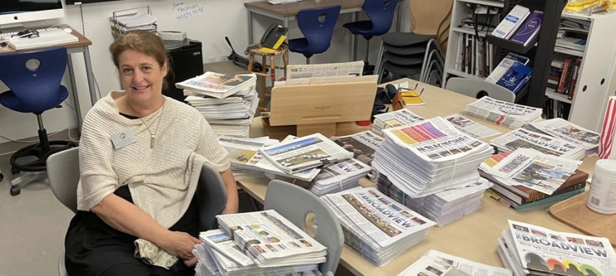 Scholastic+Journalism+%26+Media+Director+Tracy+Sena+sits+by+stacks+of+The+Broadview+as+she+cleans+out+the+Publications+Lab+before+retiring.+Sena+has+advised+The+Broadview+for+more+than+two+decades+and+has+overseen+newspapers+for+both+high+school+divisions%2C+Convent+Elementary+and+the+yearbooks.+