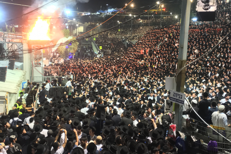 BEFORE: Thousands of an estimated 100,000 Haredim and others at Mount Meron sang and swayed together around a huge Lag B