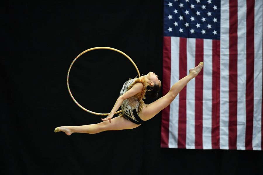 Freshman Hannah Jung performs a split leap with deep arch during her hoop routine on April 17 at her 2021 USA Gymnastics Junior Level 9 Classic and Regional Team Championships in Grand Rapids, Mich.