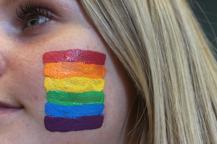 Junior+Maggie+Miller+supporting+the+LGBTQ%2B+community+by+previewing+the+Pride+flag+on+her+cheek.