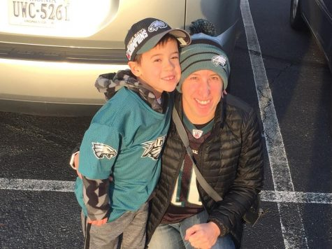 Psychology teacher Sheryl Freedman and her son pose for a photo before watching the Philadelphia Eagles take on the Washington Football Team.