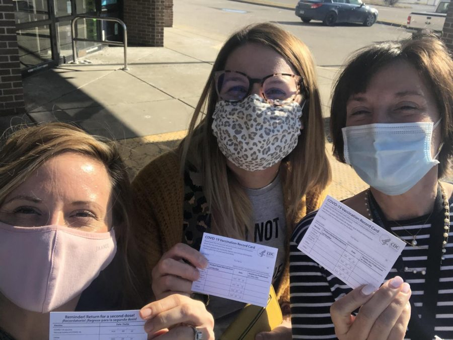 Taking+a+selfie+with+fellow+teachers%2C+librarian+Lauren+Reusch+displays+her+vaccination+card.+Reusch+travelled+with+English+teachers+Erin+Fluchel+and+Shannan+Cremeens+to+Illinois+to+be+vaccinated.+%E2%80%9CI+am+most+excited+to+go+out+to+eat+in+an+actual+restaurant+with+my+husband%2C%E2%80%9D+Reusch+said.+
