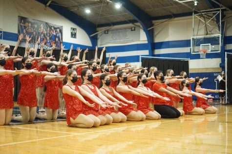 """STICKING WITH TRADITION: The McCallum Blue Brigade sticks the final pose during Last Dance to conclude their first Spring Show of 2021 on Friday April 16. """"My favorite dance is 'Last Dance' because its such a classic!"""" junior member Natalie Dean said. I think it's so fun, happy and a great way to end spring show every year,"""" The routine is full of memories for members past and present as it has been performed at the end of every spring show since 1991. Speaking of traditions, Dean helped to keep another spring show tradition alive when she made a slide show that included photos from the season as well as a tribute to seniors that included current and baby pictures of each graduating dancer. Reporting by Grace Nugent."""