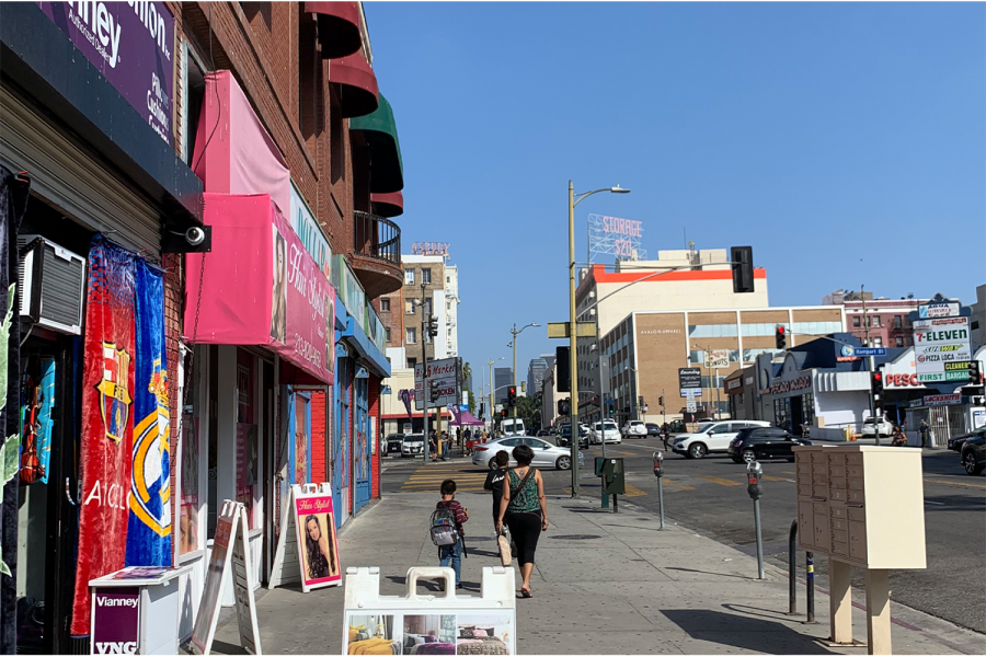 A mother and her two children walk away from a Laraya's Bodega, a local grocery store. The grocery store is located in the middle of downtown Los Angeles and puts an emphasis on healthy nutritious food. According to Feeding America, inn 2020, an estimated 265,000,000 were living with food insecurity, partially due to lack of access to healthful food and affordable groceries.