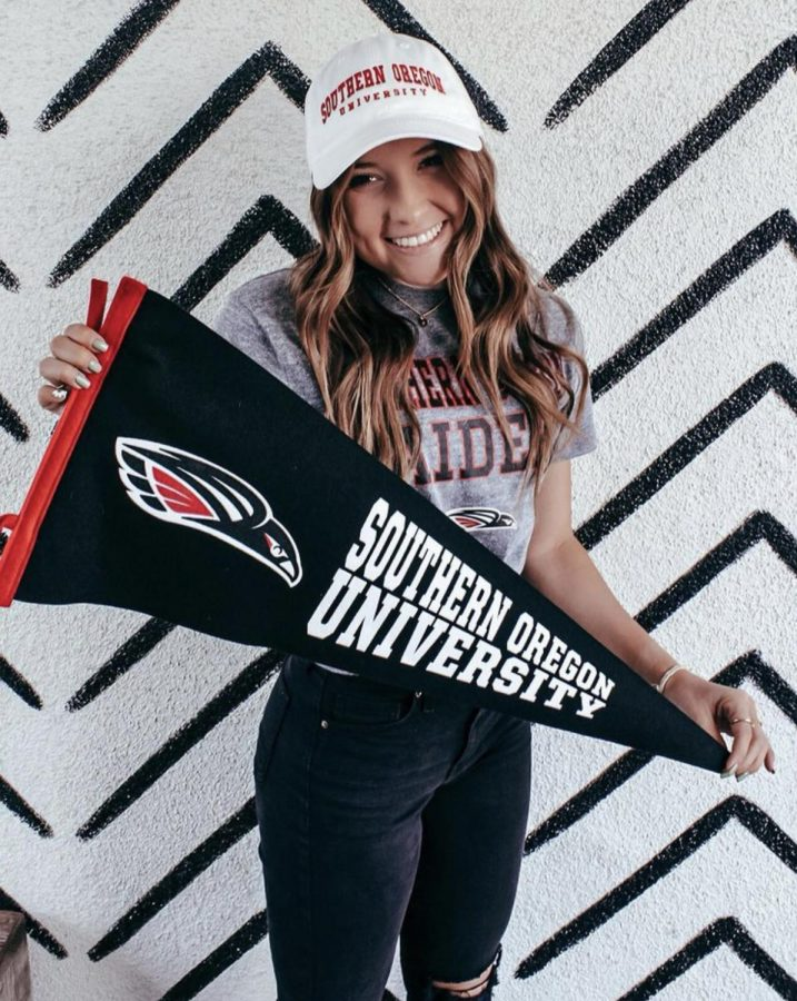 Senior Kami Klapp with a pennant from Southern Oregon University, which she will attend on a softball scholarship.