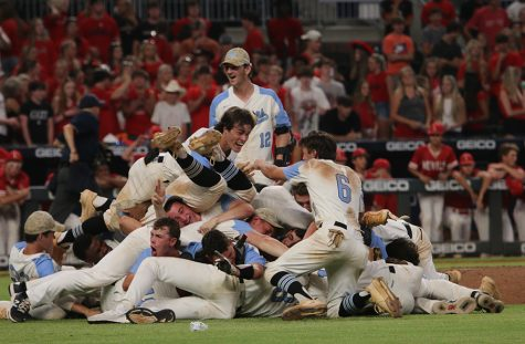 """Seniors Ryder Wagenknecht (left) and Chay Yeager (right) celebrate atop a dogpile at the end of the AAAAA state championship game against the Loganville Red Devils. Against a Loganville team vying for their fourth consecutive state title, the Panthers outplayed the Red Devils in two tight games to sweep Loganville 1-0 and 4-2 to win the state championship. This win was the first time Starr's Mill has ever won the state championship. """"It's been a long time since I've been wanting one of these,"""" Yeager said. """"We've earned it."""" Next year, Wagenknecht will play at Flagler College and Yeager will play at Wofford College."""