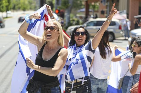 Leah Orly and Gali Reuben show their support for Israel at a protest in Agoura Hills, CA. on Sunday, May 23, 2021. The protest was to demonstrate support for Israel after the May 21 ceasefire between Israel and Hamas. Photo credit: Ryan Bough