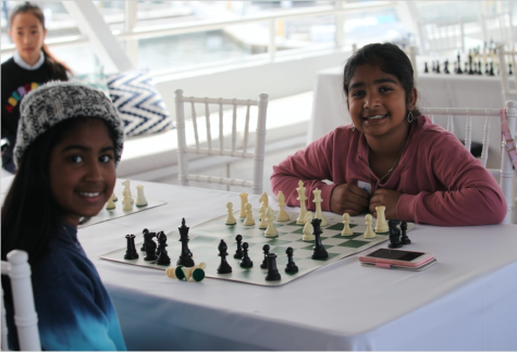 """Girls playing each other prior to the COVID-19 pandemic as part of the """"Promoting to Queens"""" program. This is representative of the efforts being made to make girls and women feel more included in the male-dominated chess community."""