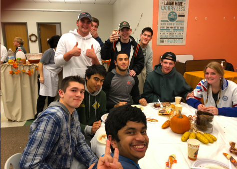 """The 2019 Lunch Bunch club members join in room B127 for a Thanksgiving dinner. """"My favorite experience has been forming relationships with people—which doesn't just happen in one single moment,"""" junior Jonny Goldin said. """"It takes time to form any kind of connection with anybody, and all that time I've spent forming these relationships is my personal favorite experience at the club."""""""