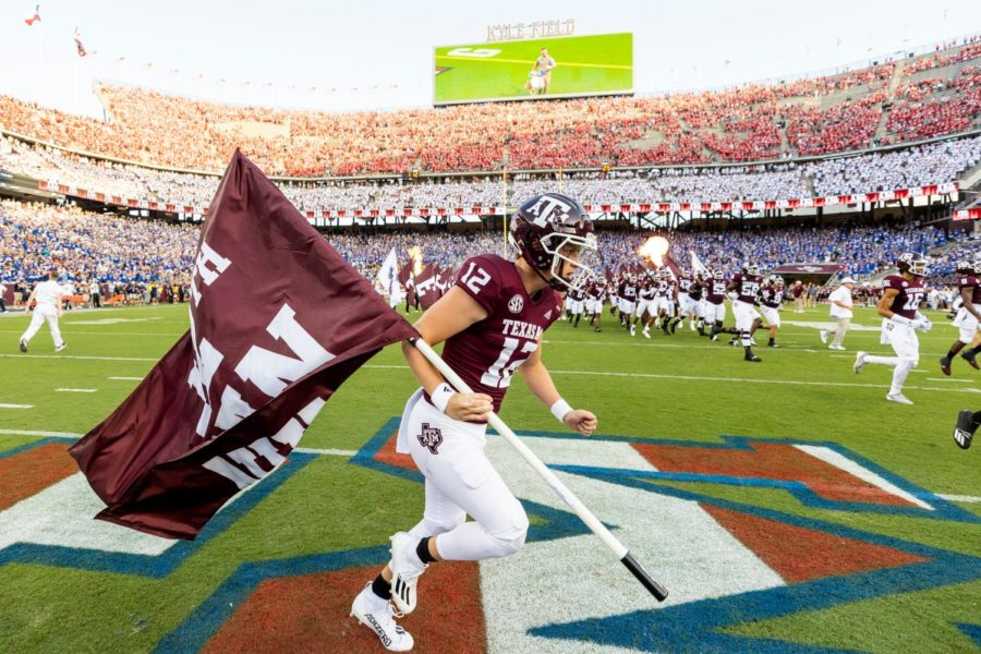 Texas A&M deep snapper Connor Choate runs the flag for the Aggies against Kent State on Sept. 4 at Kyle Field. Choate, a CHS 2017 graduate, was named as the 12th Man for this year on Aug. 28.