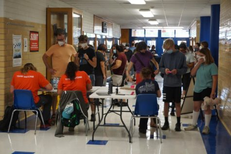 Community members wait in line at the vaccination clinic, held on May 14 at McCallum. The clinic, which offered shots to anyone 12 and older, ran from 3:30-8 p.m. and administered 383 shots.