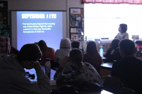 Cathy Barker teaches about 9/11 in her humanities class. Many DMS teachers have stories about where they were when the attacks occurred.