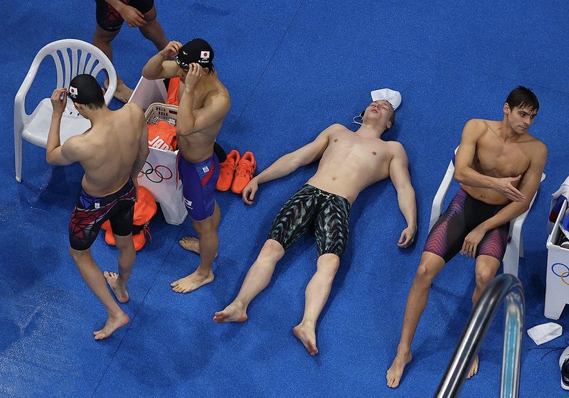 After+his+second+fourth-place+finish+at+the+2020+Tokyo+Olympics%2C+Andrei+Minakov+lay+paralyzed+in+pain+and+disappointment.