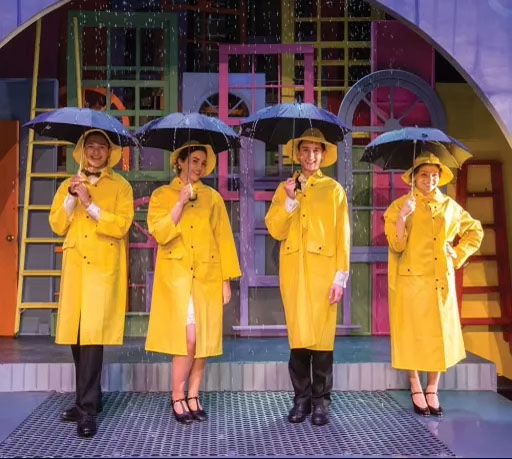 Cast members of the Upper School musical in 2019, Singing in the Rain.