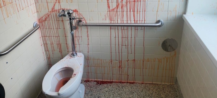 A+student+vandalized+the+boys+C300+bathroom+with+red+and+orange+pigment.+Custodians+were+unable+to+remove+the+pigment+from+the+flooring.