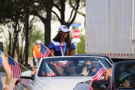 Coppell High School alumna and Olympian Chiaka Ogbogu arrives at the start of the parade surrounded by her family. Ogbogu is the first Olympian from Coppell and won gold alongside the U.S. Olympic womens volleyball team.