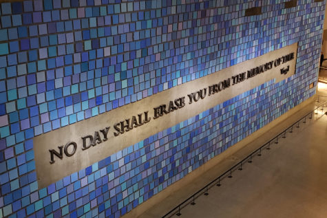 """Occupying a huge wall in the 9/11 Memorial & Museum, this mural created by Spencer Finch is titled """"Trying to Remember the Color of the Sky on That September Morning"""". Comprised of 2,983 watercolor squares, it features a quote from Roman poet Virgil that reads """"No day shall erase you from the memory of time""""."""