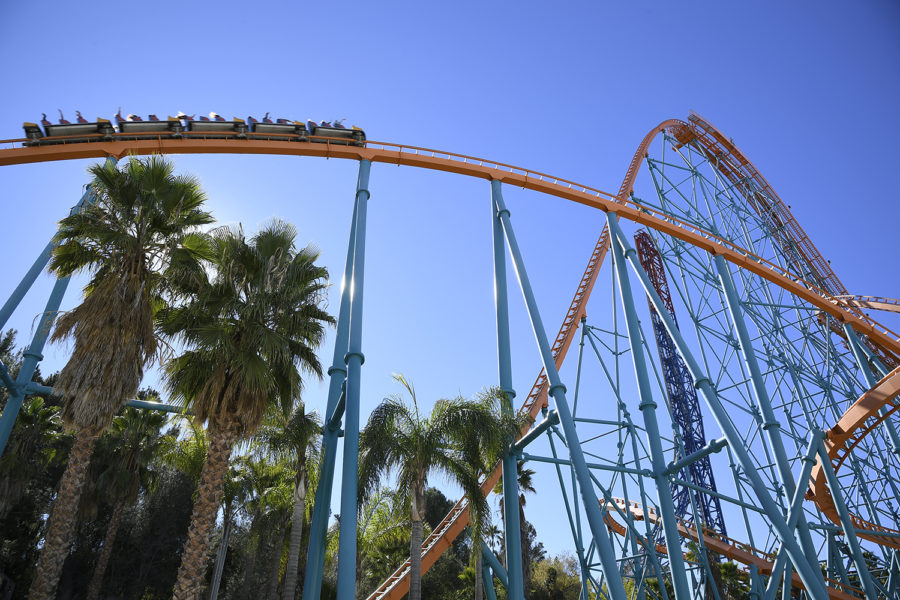 A+roller+coaster+train+swerves+through+Goliath%E2%80%99s+track+at+the+world%E2%80%99s+fastest+wooden+coaster+speed+of+72+mph+as+it+nears+the+record-breaking+180+foot+drop.+This+was+one+of+the+many+rides+in+which+several+park+goers+remained+unmasked%2C+which+sparked+concerns+from+those+who+preferred+to+strictly+adhere+to+the+Center+of+Disease+Control%E2%80%99s+COVID-19+regulations.