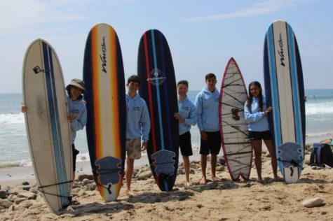 BOARDS:  Members of the Shalhevet Surf Club, along with Judaic Studies teacher Dr. Shiela Keiter, met several times during the summer and plan to continue in the 2021-22 school year. They are, from left, Dr. Keiter,  Adam Hertzberg, Akiva Rubin, Lippe Popack and Gabriella Bentolila.
