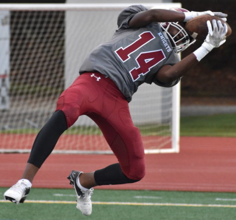 Freshman wide receiver Kenari Tigner catches the ball in a home game against Washington on Oct. 7. The Knights lost 32-0.