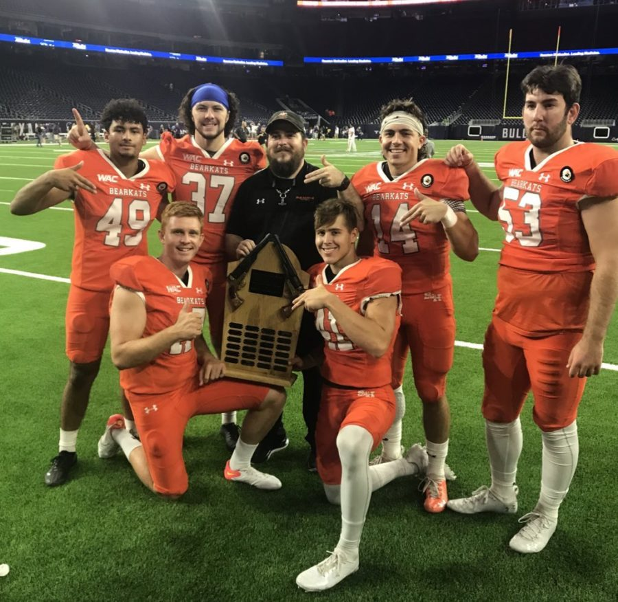 CHAMPIONS+OF+THE+BATTLE.+After+winning+the+Battle+of+the+Piney+Woods%2C+Wildkat+alumni+Christian+Pavon+%2849%29+joins+his+Bearkat+family+in+celebrating+the+victory.+