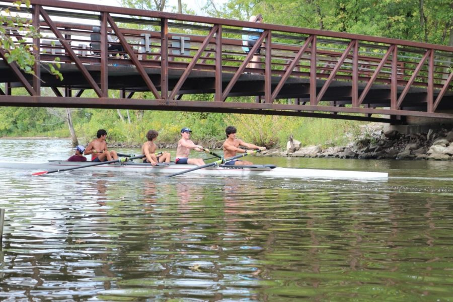 Members of St. Louis Rowing Club (SLRC) go under a bridge during practice on Sunday, Sept. 22.