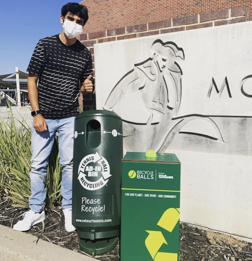 Junior Rohin Inani poses next to his two recycling bins for discarded tennis balls.